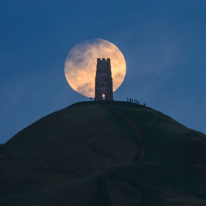 A 'wolf moon', the first supermoon of 2018, rising behind Glastonbury Tor, Somerset, on New Year's Day.